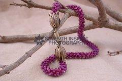 purplestripenecklaceonbranch